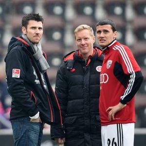 Ralph Gunesch mit dem damaligen Co-Trainer Timo Schultz und Fabian Boll (v.r.)